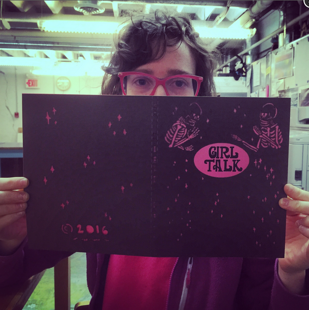 Anna Mcglynn showing off the laser cut covers of Girl Talk